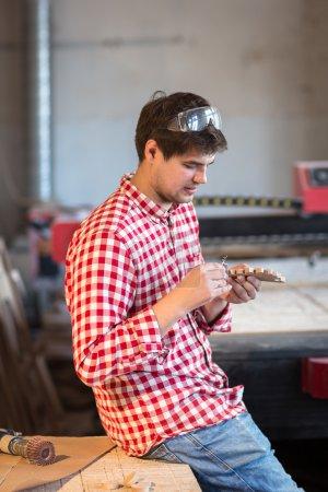 master carpenter hand polishing sandpaper wooden piece of wood t