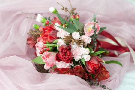 Photo for Beautiful spring bouquet of carnations and tulips. - Royalty Free Image