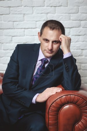 Confident and thoughtful man in suit