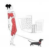 Girl walking her dachshund