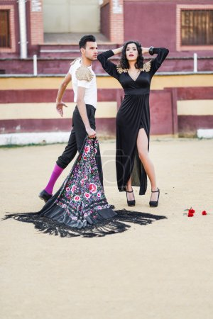 Photo for Portrait of a pretty couple, models of fashion, in a bullring. Spanish style - Royalty Free Image