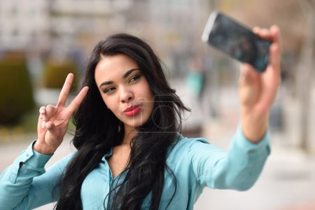 Beautiful young woman selfie in the park
