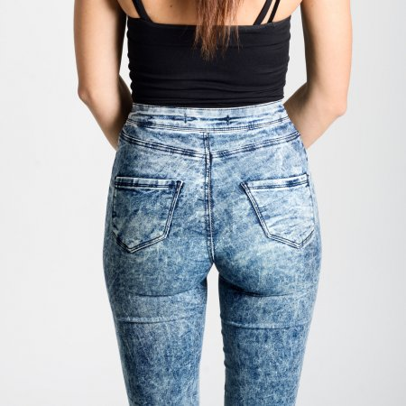 Back side of woman wearing high-waisted jeans