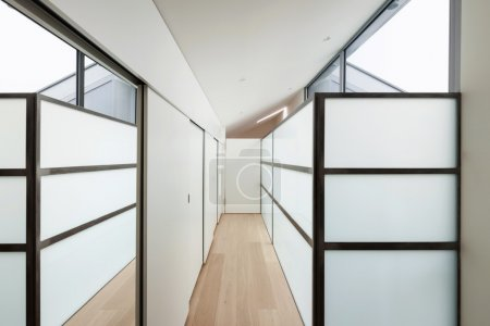 Photo for Interior of a modern house, long corridor with wall closets - Royalty Free Image