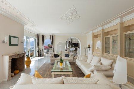 Living room, confortable white divans