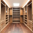 Wide wooden dressing room, interior of a modern ho...