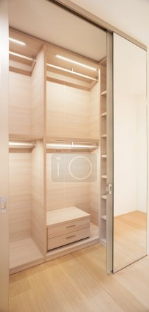 Elegant wooden walk-in closet ( mostly for women )
