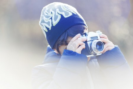 Boy plays with camera