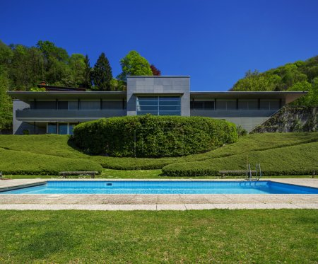 Outside of modern house in summer, swimming pool