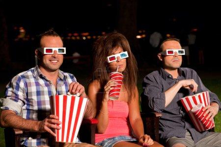 Three friends watching a movie