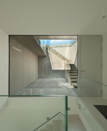 staircase with large window