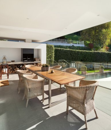 Veranda, wooden table and wicker chairs