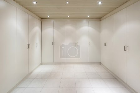 Photo for Interior of an house, empty room with a closets, tiled floor - Royalty Free Image