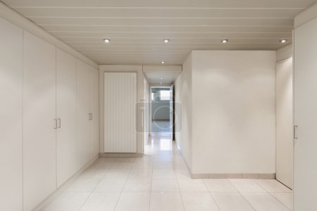 Photo for Interior of an house, empty room with closets, tiled floor - Royalty Free Image