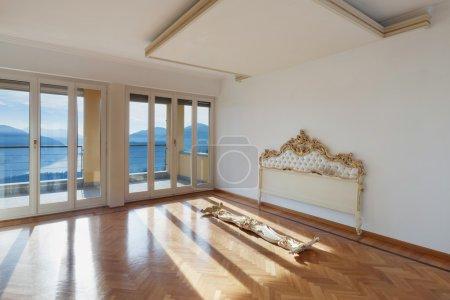 Interior,  empty room with headboard