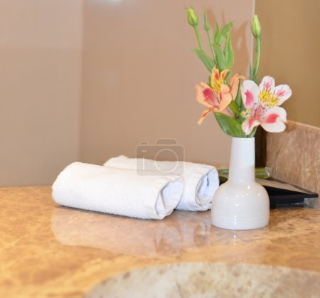 Bathroom interior rolled up towels