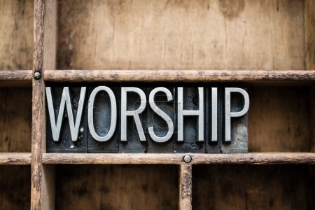 """Photo for The word """"WORSHIP"""" written in vintage metal letterpress type in a wooden drawer with dividers. - Royalty Free Image"""