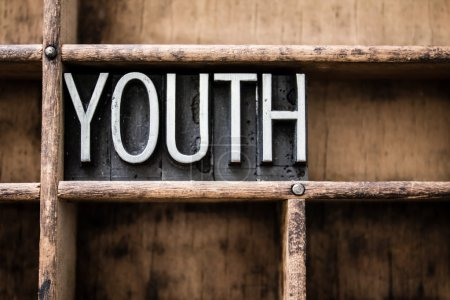 "Photo for The word ""YOUTH"" written in vintage metal letterpress type in a wooden drawer with dividers. - Royalty Free Image"