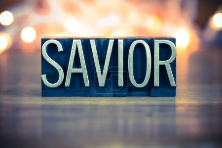 Photo for The word SAVIOR written in vintage metal letterpress type on a soft backlit background. - Royalty Free Image