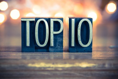 Photo for The word TOP 10 written in vintage metal letterpress type on a soft backlit background. - Royalty Free Image