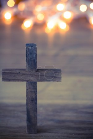 Photo for A wooden Christian cross with a soft bokeh lights background. - Royalty Free Image