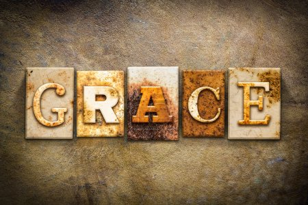 "Photo for The word ""GRACE"" written in rusty metal letterpress type on an old aged leather background. - Royalty Free Image"
