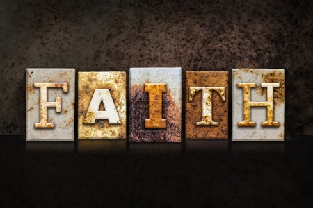 """Photo for The word """"FAITH"""" written in rusty metal letterpress type on a dark textured grunge background. - Royalty Free Image"""