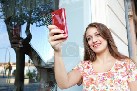 woman taking a selfie with smartphone