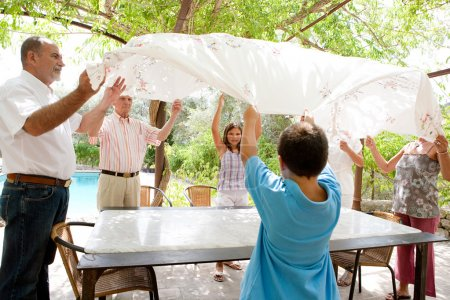 family getting ready for eating lunch outdoors