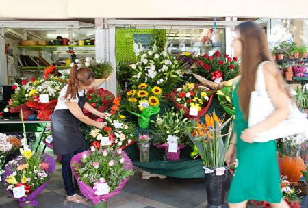 florist woman works in her store