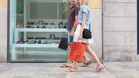 couple walking in shopping street