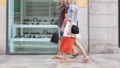 Couple walking in shopping street