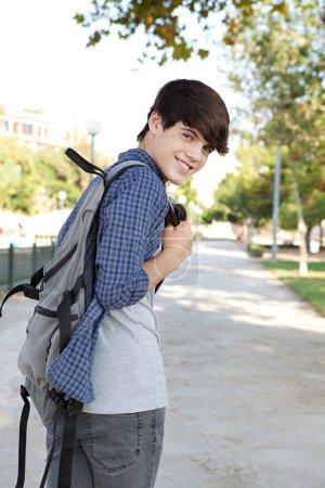 boy walking at a college campus