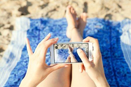 woman holding a modern technology smartphone