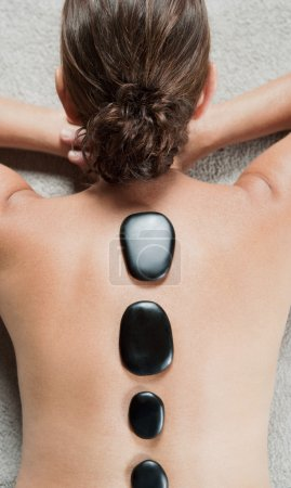 woman's back relaxing and laying down in a health spa