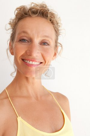 mature woman enjoying life and smiling