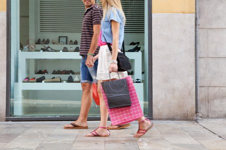 couple walking with shopping bags