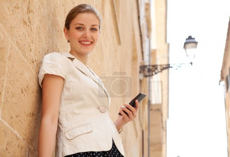 business woman holding a smartphone and smiling