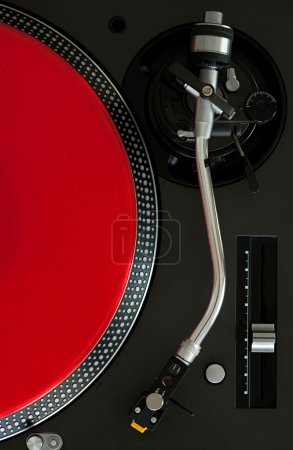record player with a red vinyl album
