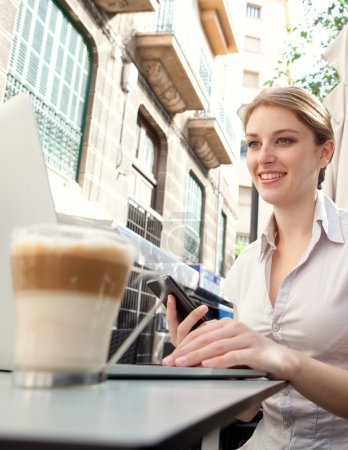 business woman using laptop computer at cafe