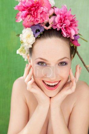 woman wearing a spring flowers hair dress