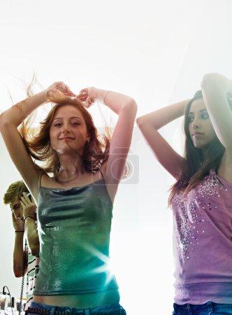 women dancing in a night club party