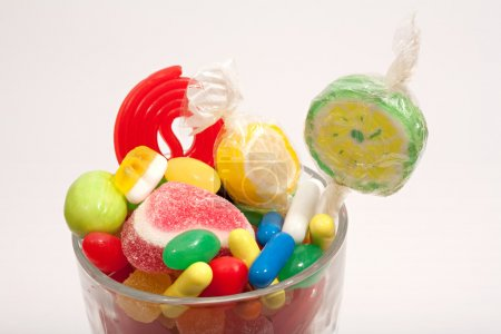 glass jar container with candy sweets and jelly beans