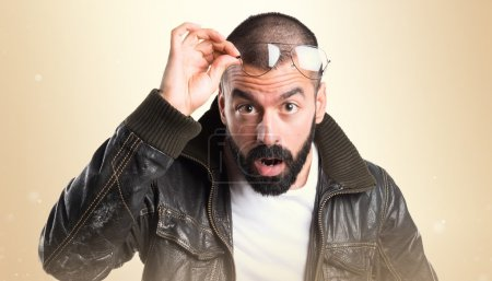 Photo for Man with leather jacket showing something - Royalty Free Image