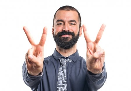 Man doing victory gesture