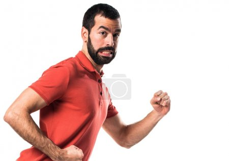 Photo for Handsome man running fast - Royalty Free Image