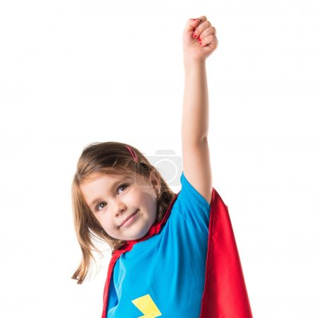 Girl dressed like superhero making fly gesture