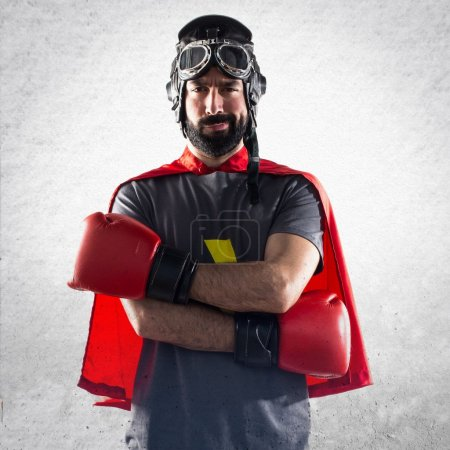 Superhero with boxing gloves with his arms crossed