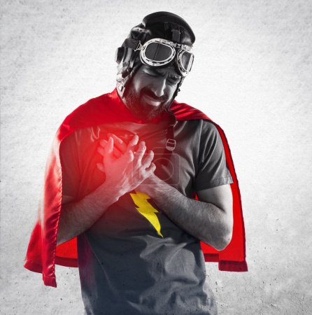 Superhero with heart pain