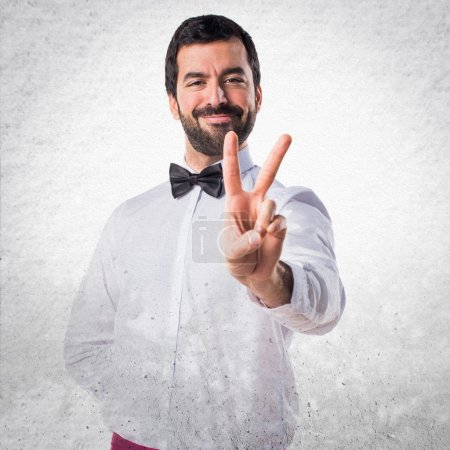 Waiter doing victory gesture